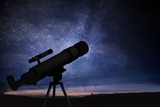 Astronomy and stars observing concept. Silhouette of telescope and starry night sky in background.