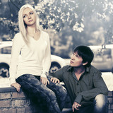 Young fashion couple in conflict on city street