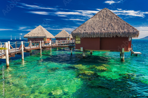 Overwater bungalows with best beach for snorkeling, Tahiti, Polynesia