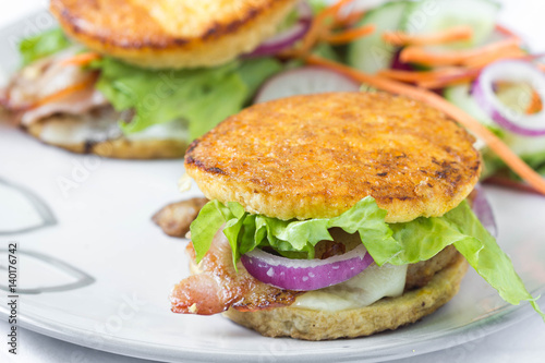 Grain free burger in fried egg bun with vegetables. Poster