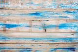 Old wooden background with blue paint. vintage wood texture from beach in summer.