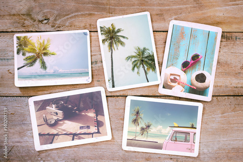 Fototapeta Summer photo album on wood table. Photography from beach vacation - vintage postcards and retro styles