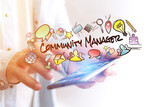 Concept of man holding smartphone with community manager title and multimedia icons flying around