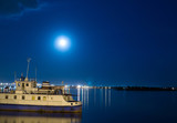 old ship at the pier on the river. summer moonlit night
