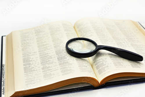 Old books with magnifying glass. Poster