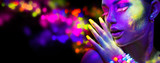 Fototapety Beauty woman in neon light, portrait of beautiful model with fluorescent makeup