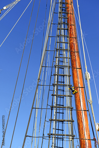 Fotobehang Zeilen Nautical maritime scene with ropes and mast on a ship on a dock by the water