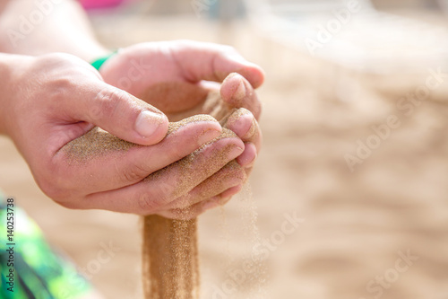 Hands strew sand running Poster
