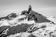 The distinctive peak of The Black tusk mountain in Black and White from the summit of Whistler mountain in winter