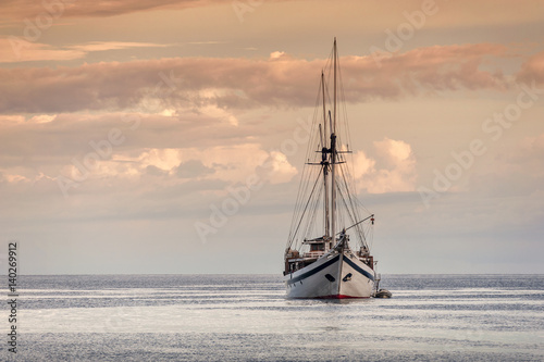 Indonesian Phinisi Schooner at Sunset. A traditional Phinisi schooner anchored off Waigeo Island in the Raja Ampat  area of West Papua, Indonesia. - 140269912