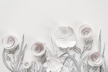3d paper flowers with painted leaves and stems on the white background © EkaterinaVladimirova