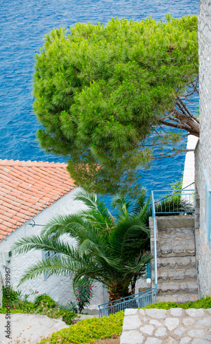 photo of cozy beautiful street on the sea background in sunny Greece