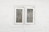 White window and white brick wall