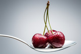 cherry on curved spoon