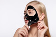 Quadro Young attractive girl takes off black facial face