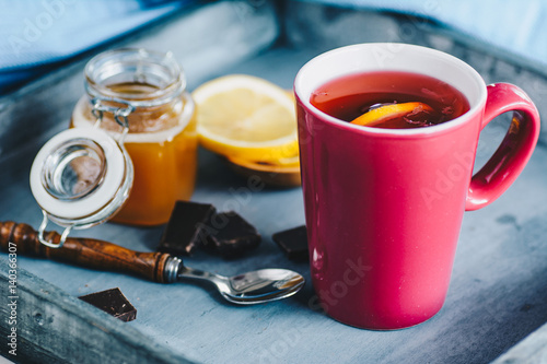 Tea with lemon and honey on wooden tray Poster