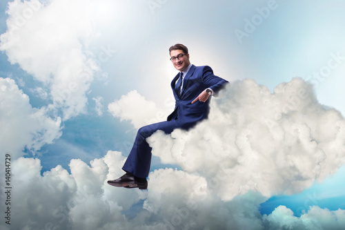 Businessman sitting on the cloud in motivitation concept