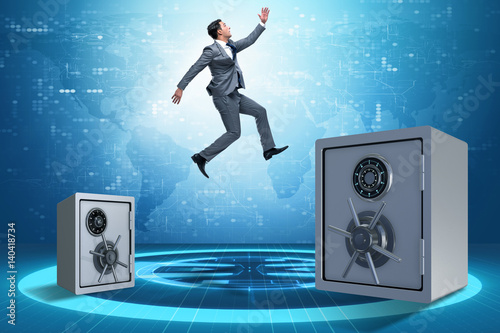 Businessman jumping from safes in business concept