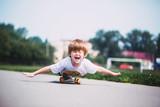 Funny boy on a skateboard.