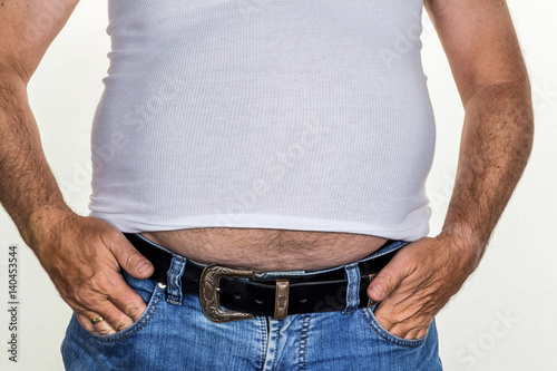 Zdjęcia na płótnie, fototapety, obrazy : Mann mit Übergewicht