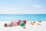 Fototapety Easter on tropical beach background. Eggs on the white sand. Vacation and travel concept