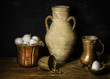Still life with fresh white eggs placed in copper pan with old jar,colorful mixed pepper on rustic wooden background.