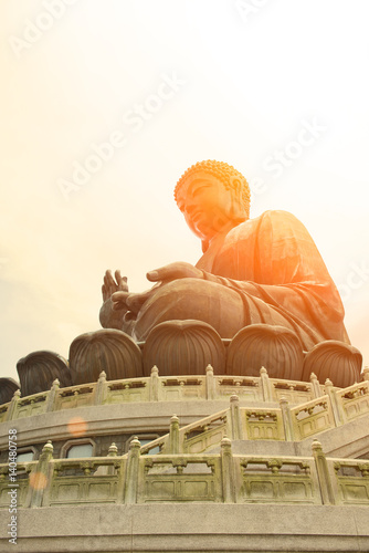 Poster HONG KONG, CHINA - MARCH  7, 2014: The enormous Tian Tan Buddha at Po Lin Monast