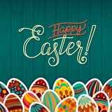 Happy Easter Greeting Card. Dark Green Wooden Background Calligraphy. Congratulations on the Holiday. A lot of Easter eggs.