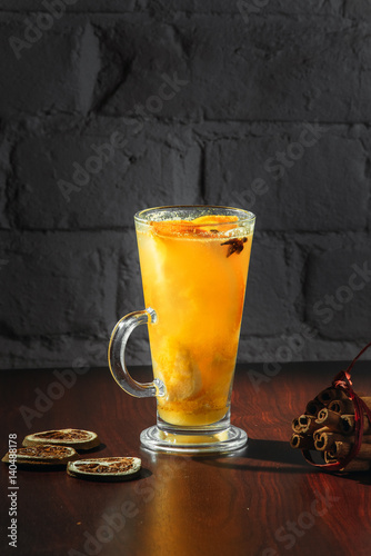 Winter healing ginger drink with honey and oranges. Cinnamon, star anise, fir twigs, tangerines, dried grapefruit.