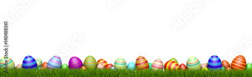Leinwanddruck Bild Ostereier im GRAS / Ostern / Hintergrund weiß