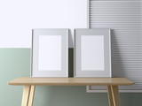 Two blank frame poster mock up on the table in the interior. 3d rendering