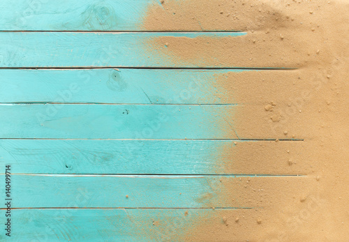 Fototapeta Sea sand on blue wooden floor,Top view with copy space
