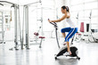 Aerobics spinning woman exercise workout at bikes gym