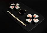 Sushi with tuna on slate plate with chopsticks