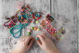 man hand making earrings of polymer clay. Hobby, handicraft background