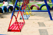 metal swing colorful in playground.