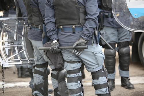 police in riot gear during the anti-terrorism control Poster