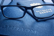 Glasses on diploma of higher education and employment history book