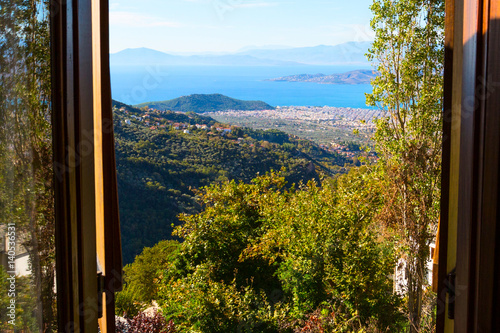 Volos city and gulf aerial view from the window at Pelion mount, Greece