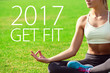 Young woman meditates while practicing yoga. Freedom concept. Motivation text 2017 get fit