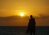 Masai watching sunset in Zanzibar