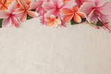 Frangipani, Plumeria, Hibiscus flowers on linen, copy space background, selective focus, vintage tone - 140557319
