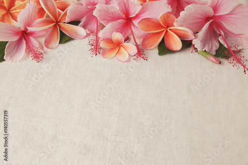 Aluminium Plumeria Frangipani, Plumeria, Hibiscus flowers on linen, copy space background, selective focus, vintage tone