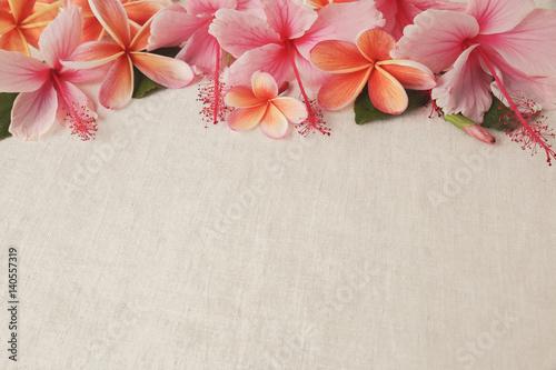 Fotobehang Plumeria Frangipani, Plumeria, Hibiscus flowers on linen, copy space background, selective focus, vintage tone