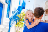 Happy dad and little adorable girl in greek village during summer vacation - 140587773