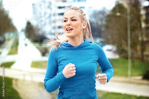 Blonde woman is jogging