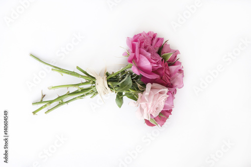 Bouquet of natural roses on white background.