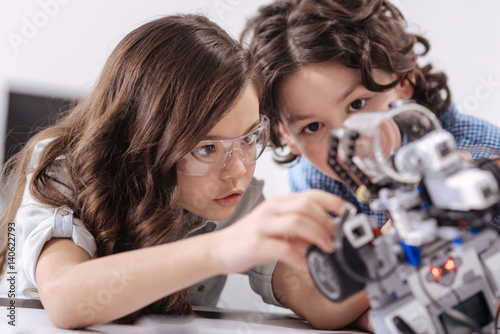 Inventive kids enjoying science lesson at school
