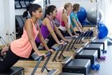 Group of women exercising on reformer