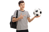 Teen student holding a football and pointing